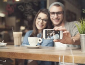Couple Smiling Selfie Coffee Shop