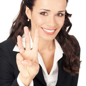 Business Woman Showing Three Ways Dental Crowns Can Help Her Smile