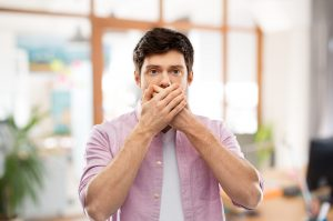 man hiding bad breath